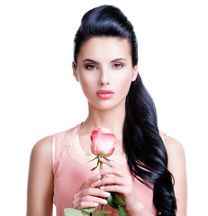 Sensual beautiful woman with pink rose.