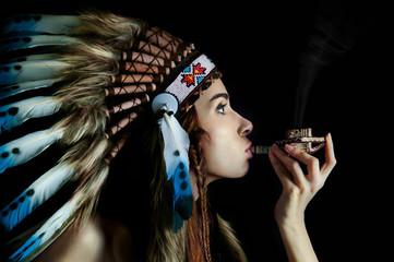 American Indian girl smoking a pipe