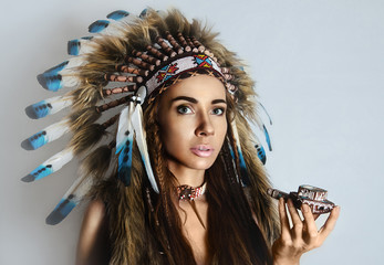 American Indian girl smoking a pipe