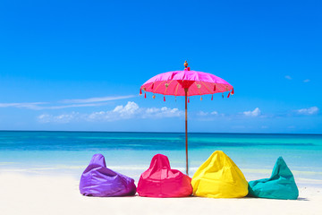 colorful pillows and bright umbrella on tropical sea and beach b