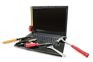 Computer repair with set of tools over white