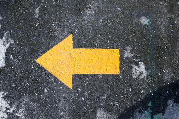 arrow on the asphalt road