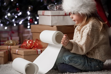 Child reading a letter to the wishes of Santa Claus