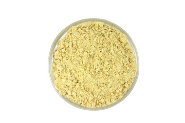 seasoning yellow in a glass container on white background