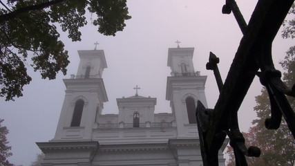 christianity church towers in morning fog and bell sound