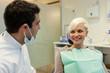 interaction between european dentist and blonde patient