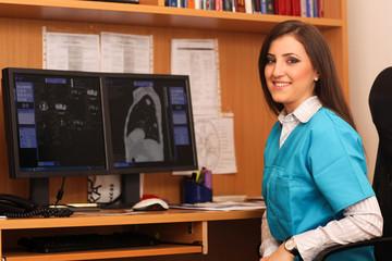Portrait of a smiling female doctor sitting at work desk
