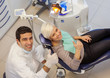 top view of caucasian dentist doing his job on a young blonde wo