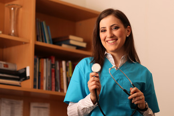 Female doctor smiling with stethoscope in hands