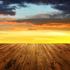 wooden planks and beautiful colorful sunset