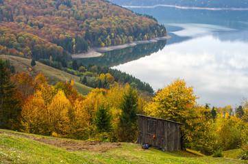 Autumn landscape with alpine hut