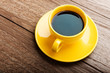 Cup of coffee on old white wooden table.