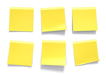 Set of yellow sticky notes used in an office for reminders