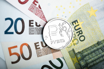 russian ruble coin on the European banknotes (five and ten)