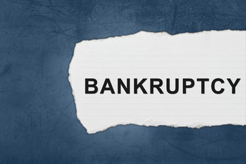 bankruptcy with white paper tears