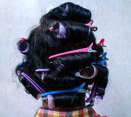 Asia Woman with hair curlers