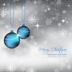 Blue bauble and snowflakes on a christmas winter background
