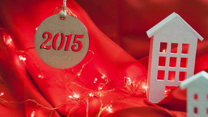 New Year 2015. Decorative composition homes on a red background.