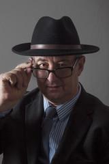 Serious men portrait with hat