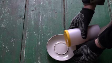 farmer opening new poison toxic bottle for pest rat mouse