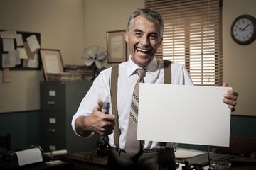 Smiling vintage businessman holding a blank sign