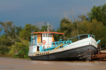 Boat anchored on the banks of the parana river