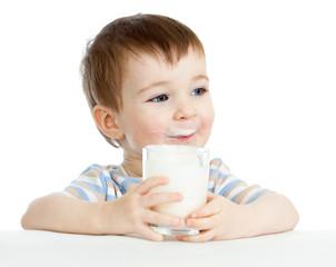 child drinking milk from glass