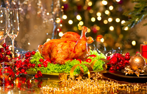canvas print picture Christmas dinner. Holiday decorated table with roasted turkey