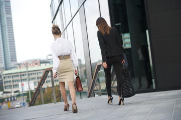 businesswomen walking