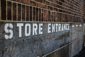 Store Entrance stenciled on building exterior
