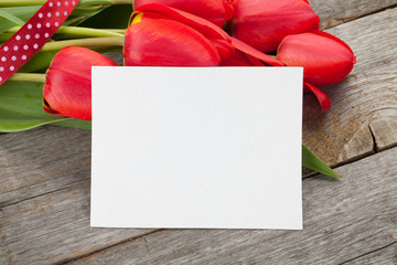 Fresh tulips and greeting card