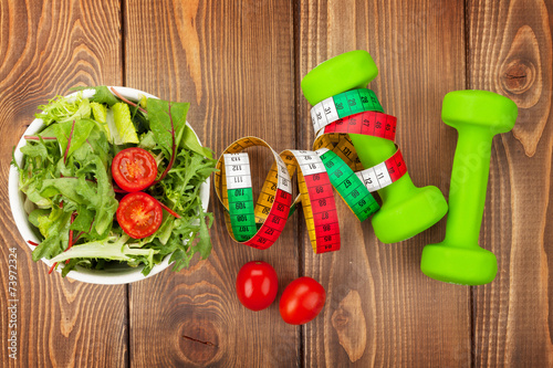 Tuinposter Gymnastiek Dumbells, tape measure and healthy food. Fitness and health