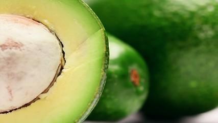 Close up view of a sliced avocado fruit,rotating