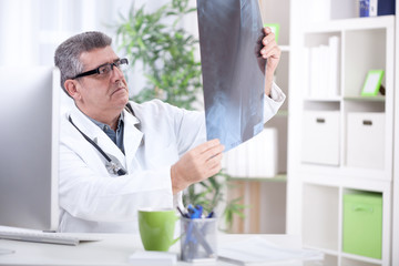 senior orthopedist doctors examine X-rays