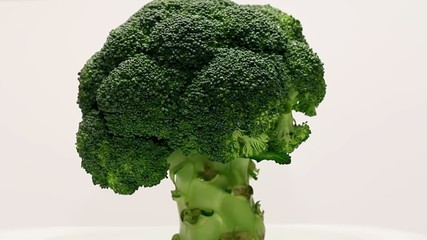 Rotating broccoli on a white background
