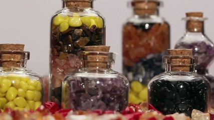 Rotating mini gemstone bottles