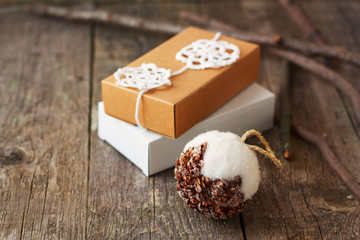 Christmas gifts, decorated with eco-friendly style on the wooden