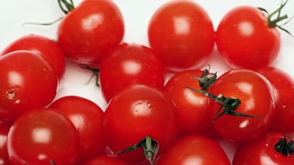 Rotating cherry tomatoes on a white background