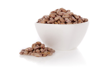 Pinto beans in a bowl isolated on a white background