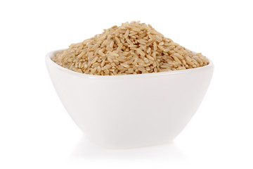 Brown rice in a bowl isolated on a white background