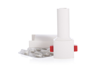 Asthma inhaler isolated on a white background