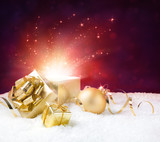 magic shining of christmas present on snow