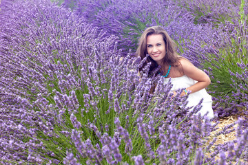 Beautiful girl smiling in a field of lavender