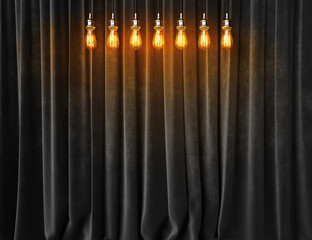 Vintage lightbulbs on velvet curtains background