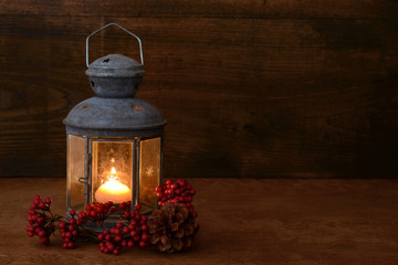 antique lantern with red berries
