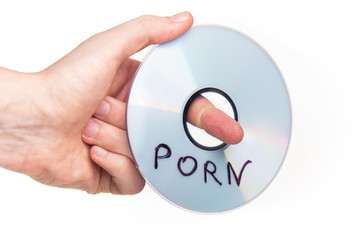 Hand holding DVD with porn movies