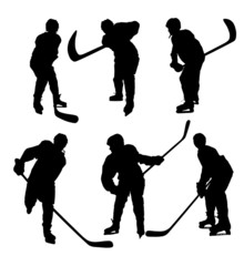 Silhouettes hockey players on white