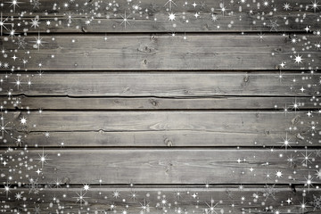 Wooden background with snow and stars