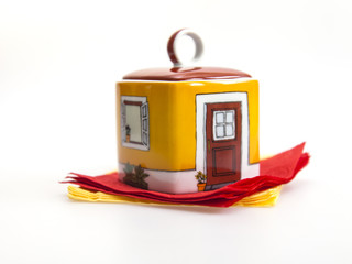 Ceramic sugar bowl and napkins on a table