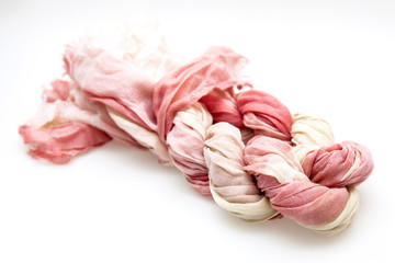 The pink scarf twisted by a plait
